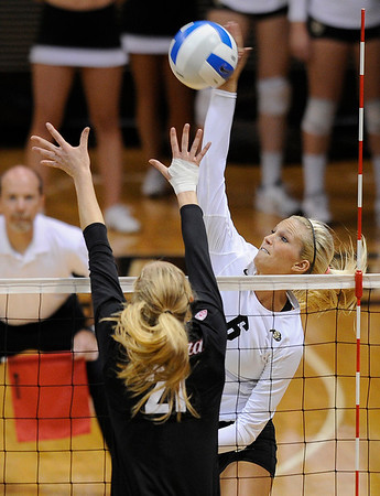 "University of Colorado's Kerra Schroeder kills the ball over Stanford's Hayley Spelman on Thursday, Nov. 3, during  a volleyball game against Stanford University at the Coors Event Center on the CU campus in Boulder. For more photos of the game go to  <a href=""http://www.dailycamera.com"">http://www.dailycamera.com</a><br /> Jeremy Papasso/ Camera"