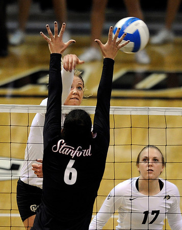 "University of Colorado's Nikki Lindow gets her kill blocked by Stanford's Rachel Williams on Thursday, Nov. 3, during  a volleyball game against Stanford University at the Coors Event Center on the CU campus in Boulder. For more photos of the game go to  <a href=""http://www.dailycamera.com"">http://www.dailycamera.com</a><br /> Jeremy Papasso/ Camera"