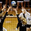 "University of Colorado's Emily Alexis goes for a kill over Stanford's Hayley Spelman, No. 21, and Carly Wopat, No. 2, on Thursday, Nov. 3, during  a volleyball game against Stanford University at the Coors Event Center on the CU campus in Boulder. For more photos of the game go to  <a href=""http://www.dailycamera.com"">http://www.dailycamera.com</a><br /> Jeremy Papasso/ Camera"