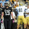 """Parker Orms of CU, watches a reply of a UCLA touchdown, while the UCLA players celebrate in the background.<br /> For more photos of the game, go to  <a href=""""http://www.dailycamera.com"""">http://www.dailycamera.com</a><br /> Cliff Grassmick / September 29, 2012"""