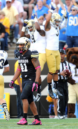 "Terrel Smith of CU, walks off the field after a UCLA TD.<br /> For more photos of the game, go to  <a href=""http://www.dailycamera.com"">http://www.dailycamera.com</a><br /> Cliff Grassmick / September 29, 2012"