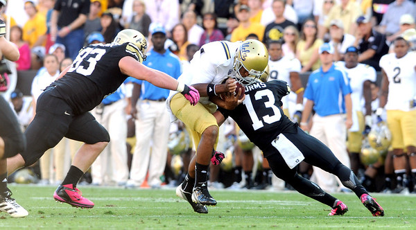 "Will Pericak, left, and Parker Orms, both of CU, wrap up Brett Hundley of UCLA.<br /> For more photos of the game, go to  <a href=""http://www.dailycamera.com"">http://www.dailycamera.com</a><br /> Cliff Grassmick / September 29, 2012"