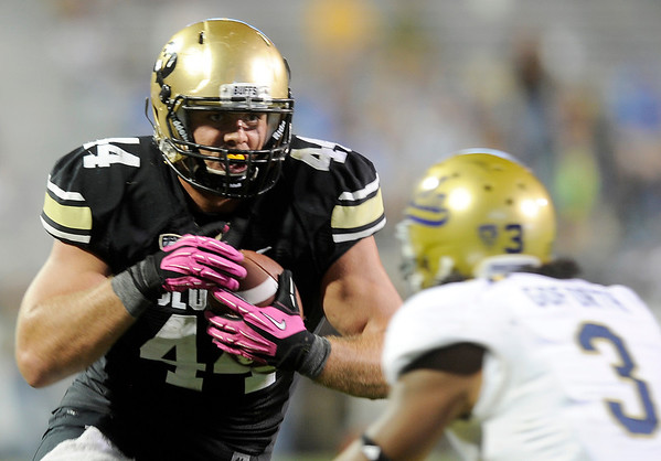 """University of Colorado's Nick Kasa runs the ball past Randall Goforth for a touchdown after catching a pass during a game against UCLA on Saturday, Sept. 29, at Folsom Field in Boulder. For more photos of the game go to  <a href=""""http://www.dailycamera.com"""">http://www.dailycamera.com</a><br /> Jeremy Papasso/ Camera"""