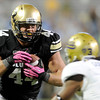 "University of Colorado's Nick Kasa runs the ball past Randall Goforth for a touchdown after catching a pass during a game against UCLA on Saturday, Sept. 29, at Folsom Field in Boulder. For more photos of the game go to  <a href=""http://www.dailycamera.com"">http://www.dailycamera.com</a><br /> Jeremy Papasso/ Camera"