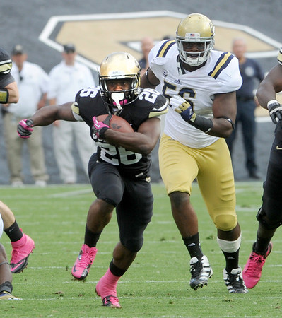 """Tony Jones of CU finds some room against UCLA.<br /> For more photos of the game, go to  <a href=""""http://www.dailycamera.com"""">http://www.dailycamera.com</a><br /> Cliff Grassmick / September 29, 2012"""