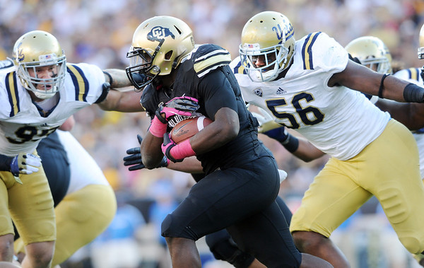 """Christian Powell of CU can't get past Datone Jones (56) of UCLA.<br /> For more photos of the game, go to  <a href=""""http://www.dailycamera.com"""">http://www.dailycamera.com</a><br /> Cliff Grassmick / September 29, 2012"""