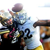 """Nelson Spruce, left, of CU, and Sheldon Price of UCLA, battle for a pass.<br /> For more photos of the game, go to  <a href=""""http://www.dailycamera.com"""">http://www.dailycamera.com</a><br /> Cliff Grassmick / September 29, 2012"""