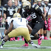 """University of Colorado's Christian Powell jukes Tevin McDonald while rushing the ball during a game against UCLA on Saturday, Sept. 29, at Folsom Field in Boulder. For more photos of the game go to  <a href=""""http://www.dailycamera.com"""">http://www.dailycamera.com</a><br /> Jeremy Papasso/ Camera"""