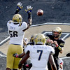 "CU QB, Jordan Webb, gets the ball around Datone Jones of UCLA.<br /> For more photos of the game, go to  <a href=""http://www.dailycamera.com"">http://www.dailycamera.com</a><br /> Cliff Grassmick / September 29, 2012"