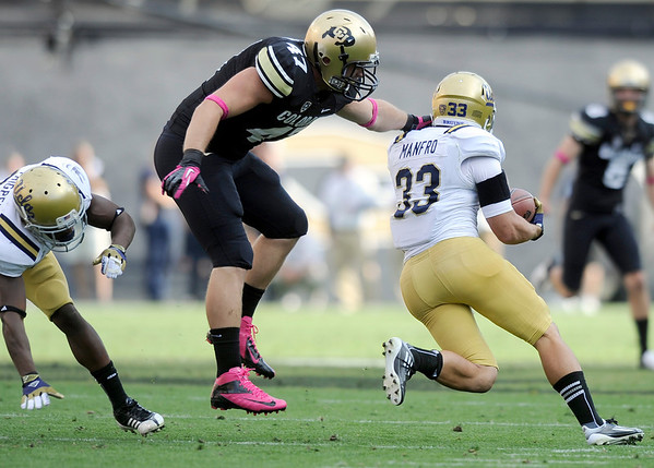 "University of Colorado's Alex Wood misses a tackle on Steven Manfro on a punt return during a game against UCLA on Saturday, Sept. 29, at Folsom Field in Boulder. For more photos of the game go to  <a href=""http://www.dailycamera.com"">http://www.dailycamera.com</a><br /> Jeremy Papasso/ Camera"