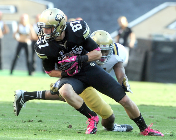 "Tyler McCulloch of CU tries to escape a UCLA defender on Saturday.<br /> For more photos of the game, go to  <a href=""http://www.dailycamera.com"">http://www.dailycamera.com</a><br /> Cliff Grassmick / September 29, 2012"