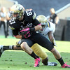 """Tyler McCulloch of CU tries to escape a UCLA defender on Saturday.<br /> For more photos of the game, go to  <a href=""""http://www.dailycamera.com"""">http://www.dailycamera.com</a><br /> Cliff Grassmick / September 29, 2012"""