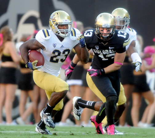 """Johnathan Franklin of UCLA tries to get past Parker Orms of CU.<br /> For more photos of the game, go to  <a href=""""http://www.dailycamera.com"""">http://www.dailycamera.com</a><br /> Cliff Grassmick / September 29, 2012"""