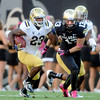 "Johnathan Franklin of UCLA tries to get past Parker Orms of CU.<br /> For more photos of the game, go to  <a href=""http://www.dailycamera.com"">http://www.dailycamera.com</a><br /> Cliff Grassmick / September 29, 2012"