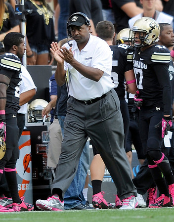 """University of Colorado head coach Jon Embree claps after forcing a punt during a game against UCLA on Saturday, Sept. 29, at Folsom Field in Boulder. For more photos of the game go to  <a href=""""http://www.dailycamera.com"""">http://www.dailycamera.com</a><br /> Jeremy Papasso/ Camera"""