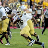 "Jordan James of UCLA scores a second half touchdown against CU.<br /> For more photos of the game, go to  <a href=""http://www.dailycamera.com"">http://www.dailycamera.com</a><br /> Cliff Grassmick / September 29, 2012"