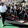 University of Colorado head coach, Jon Embree, prepares to lead his team behind Ralphie for the start of the CU UCLA game.<br /> Cliff Grassmick  / September 29, 2012