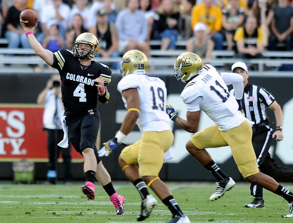 "University of Colorado quarterback Jordan Webb completes a pass in front of Dalton Hilliard, No. 19, and Anthony Barr during a game against UCLA on Saturday, Sept. 29, at Folsom Field in Boulder. For more photos of the game go to  <a href=""http://www.dailycamera.com"">http://www.dailycamera.com</a><br /> Jeremy Papasso/ Camera"