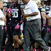 """University of Colorado head coach Jon Embree talks with Greg Henderson on the sideline during a game against UCLA on Saturday, Sept. 29, at Folsom Field in Boulder. For more photos of the game go to  <a href=""""http://www.dailycamera.com"""">http://www.dailycamera.com</a><br /> Jeremy Papasso/ Camera"""