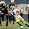 """University of Colorado's Vincent Hobbs fumbles the ball after being hit by Randall Goforth, No. 3, during a game against UCLA on Saturday, Sept. 29, at Folsom Field in Boulder. For more photos of the game go to  <a href=""""http://www.dailycamera.com"""">http://www.dailycamera.com</a><br /> Jeremy Papasso/ Camera"""