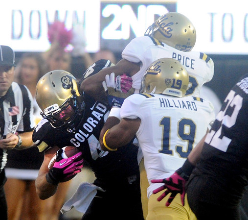 """Nick Kasa of CU is knocked out by Sheldon Price of UCLA.<br /> For more photos of the game, go to  <a href=""""http://www.dailycamera.com"""">http://www.dailycamera.com</a><br /> Cliff Grassmick / September 29, 2012"""