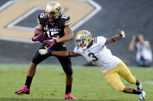 """Vincent Hobbs of CU, gets the ball knocked away by Randall Goforth of UCLA.<br /> For more photos of the game, go to  <a href=""""http://www.dailycamera.com"""">http://www.dailycamera.com</a><br /> Cliff Grassmick / September 29, 2012"""