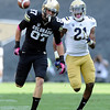 """University of Colorado's Tyler McCulloch chases after a deep pass in front of Kenneth Walker during a game against UCLA on Saturday, Sept. 29, at Folsom Field in Boulder. The pass was incomplete. For more photos of the game go to  <a href=""""http://www.dailycamera.com"""">http://www.dailycamera.com</a><br /> Jeremy Papasso/ Camera"""