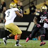 "University of Colorado's Donta Abron runs the ball past Randall Goforth, No. 3, during a game against UCLA on Saturday, Sept. 29, at Folsom Field in Boulder. For more photos of the game go to  <a href=""http://www.dailycamera.com"">http://www.dailycamera.com</a><br /> Jeremy Papasso/ Camera"