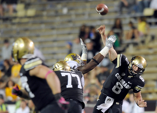 "University of Colorado quarterback Nick Hirschman throws a touchdown pass to Nick Kasa during a game against UCLA on Saturday, Sept. 29, at Folsom Field in Boulder. For more photos of the game go to  <a href=""http://www.dailycamera.com"">http://www.dailycamera.com</a><br /> Jeremy Papasso/ Camera"