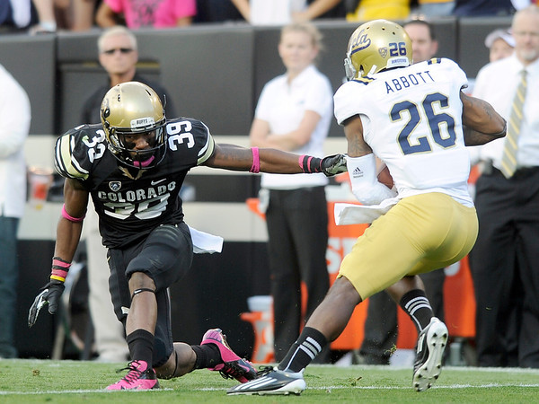 "University of Colorado's Josh Moten misses a tackle on Andrew Abbott during a game against UCLA on Saturday, Sept. 29, at Folsom Field in Boulder. For more photos of the game go to  <a href=""http://www.dailycamera.com"">http://www.dailycamera.com</a><br /> Jeremy Papasso/ Camera"