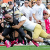 """University of Colorado's Tony Jones tries to hold onto the ball while being tackled by Damien Holmes during a game against UCLA on Saturday, Sept. 29, at Folsom Field in Boulder. For more photos of the game go to  <a href=""""http://www.dailycamera.com"""">http://www.dailycamera.com</a><br /> Jeremy Papasso/ Camera"""