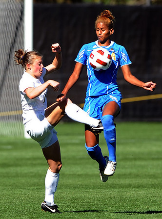 """Hayley Hughes, left, of CU, and Iman Bearde of UCLA, go for the ball.<br /> For more photos of the game, go to  <a href=""""http://www.dailycamera.com"""">http://www.dailycamera.com</a>.<br /> Cliff Grassmick / September 19, 2010"""