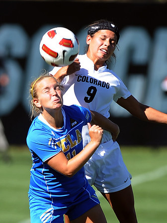"Chelsea Cline, left, of UCLA, and Kym Lowry of Colorado battle for the ball on a header.<br /> For more photos of the game, go to  <a href=""http://www.dailycamera.com"">http://www.dailycamera.com</a>.<br /> Cliff Grassmick / September 19, 2010"