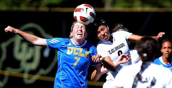 "Jenna Richmond, left, of UCLA, and Kym Lowry of Colorado battle for the ball on a header.<br /> For more photos of the game, go to  <a href=""http://www.dailycamera.com"">http://www.dailycamera.com</a>.<br /> Cliff Grassmick / September 19, 2010"