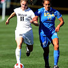 "Erin Bricker, left, of Colorado, and Chelsea Braun of UCLA, run down the ball on Sunday.<br /> For more photos of the game, go to  <a href=""http://www.dailycamera.com"">http://www.dailycamera.com</a>.<br /> Cliff Grassmick / September 19, 2010"