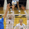 """Tabi Love, left, of UCLA, hits past Kelsey English and Anicia Santos of CU.<br /> For more photos of the game, go to  <a href=""""http://www.dailycamera.com"""">http://www.dailycamera.com</a><br /> Cliff Grassmick / October 2, 2011"""
