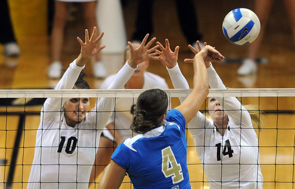 "Anicia Santos (10) and Emily Alexus, both of CU, try to defend Sara Sage of UCLA.<br /> For more photos of the game, go to  <a href=""http://www.dailycamera.com"">http://www.dailycamera.com</a><br /> Cliff Grassmick / October 2, 2011"