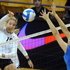 "Nikki Lindow of CU, hits past Sara Sage of UCLA.<br /> For more photos of the game, go to  <a href=""http://www.dailycamera.com"">http://www.dailycamera.com</a><br /> Cliff Grassmick / October 2, 2011"