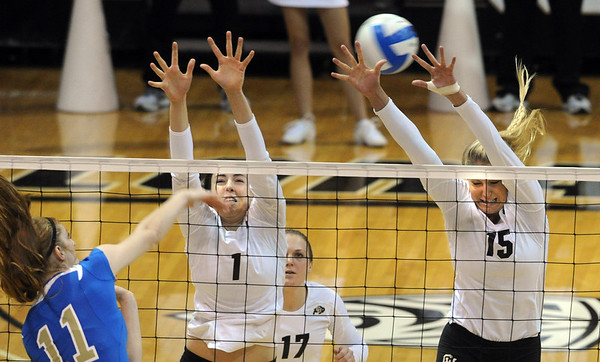 """Racheal Kidder of UCLA, hits past Kelsey English and Nikki Lindow of CU.<br /> For more photos of the game, go to  <a href=""""http://www.dailycamera.com"""">http://www.dailycamera.com</a><br /> Cliff Grassmick / October 2, 2011"""