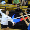 """Nikki Lindow of CU, hits past Sara Sage of UCLA.<br /> For more photos of the game, go to  <a href=""""http://www.dailycamera.com"""">http://www.dailycamera.com</a><br /> Cliff Grassmick / October 2, 2011"""
