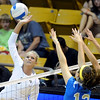 "Kerra Schroeder, left of CU hits past Mariana Aquino and Bojana Todorovic of UCLA.<br /> For more photos of the game, go to  <a href=""http://www.dailycamera.com"">http://www.dailycamera.com</a><br /> Cliff Grassmick / October 2, 2011"