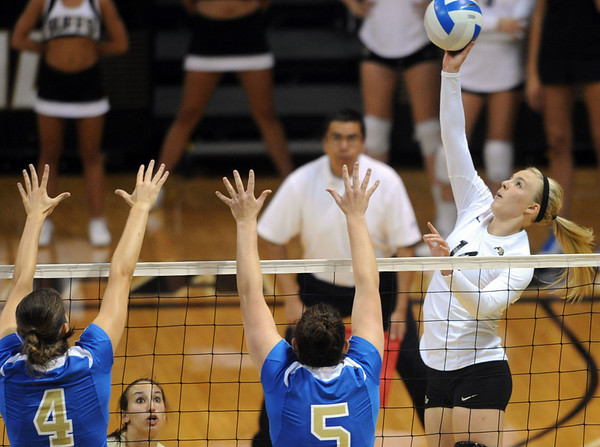 """Emily Alexus, right, of CU, tries to get the ball past Sara Sage (4) and Lauren Van Orden of UCLA.<br /> For more photos of the game, go to  <a href=""""http://www.dailycamera.com"""">http://www.dailycamera.com</a><br /> Cliff Grassmick / October 2, 2011"""