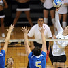 "Emily Alexus, right, of CU, tries to get the ball past Sara Sage (4) and Lauren Van Orden of UCLA.<br /> For more photos of the game, go to  <a href=""http://www.dailycamera.com"">http://www.dailycamera.com</a><br /> Cliff Grassmick / October 2, 2011"