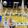 """Racheal Kidder of UCLA, hits past Michelle Miller and Nikki Lindow of CU.<br /> For more photos of the game, go to  <a href=""""http://www.dailycamera.com"""">http://www.dailycamera.com</a><br /> Cliff Grassmick / October 2, 2011"""