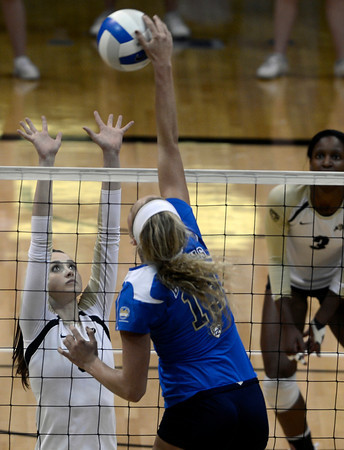 """University of Colorado's Nicole Edelman tries to block a kill from Zoe Nightingale during a volleyball match against UCLA on Friday, Nov. 9, at the Coors Event Center on the CU campus in Boulder. For more photos of the game go to  <a href=""""http://www.dailycamera.com"""">http://www.dailycamera.com</a><br /> Jeremy Papasso/ Camera"""