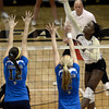 "University of Colorado's Alexis Austin goes for a kill over Nariana Aquino, left,  and Kelly Reeves during a volleyball match against UCLA on Friday, Nov. 9, at the Coors Event Center on the CU campus in Boulder. For more photos of the game go to  <a href=""http://www.dailycamera.com"">http://www.dailycamera.com</a><br /> Jeremy Papasso/ Camera"
