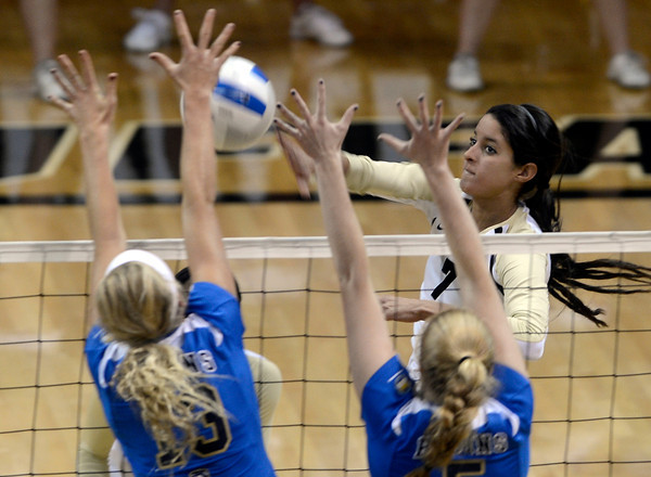 "University of Colorado's Neira Ortiz Ruiz goes for a kill over Zoe Nightingale, left, and Becca Strehlow during a volleyball match against UCLA on Friday, Nov. 9, at the Coors Event Center on the CU campus in Boulder. For more photos of the game go to  <a href=""http://www.dailycamera.com"">http://www.dailycamera.com</a><br /> Jeremy Papasso/ Camera"