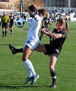 Hayley Hughes, right, of CU, gets her kicks in through Ally Courtnall of UCLA. For more photos of the game, go to www.dailycamera.com. Cliff Grassmick / October 28, 2011