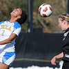"Sydney Leroux, left, of UCLA, and Lizzy Herzl of CU, get up in the air to hit the ball.<br /> For more photos of the game, go to  <a href=""http://www.dailycamera.com"">http://www.dailycamera.com</a>.<br /> Cliff Grassmick / October 28, 2011"