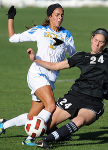 Ally Courtnall, left, of UCLA, and Maggi Steury of CU, struggle for possession of the ball. For more photos of the game, go to www.dailycamera.com. Cliff Grassmick / October 28, 2011